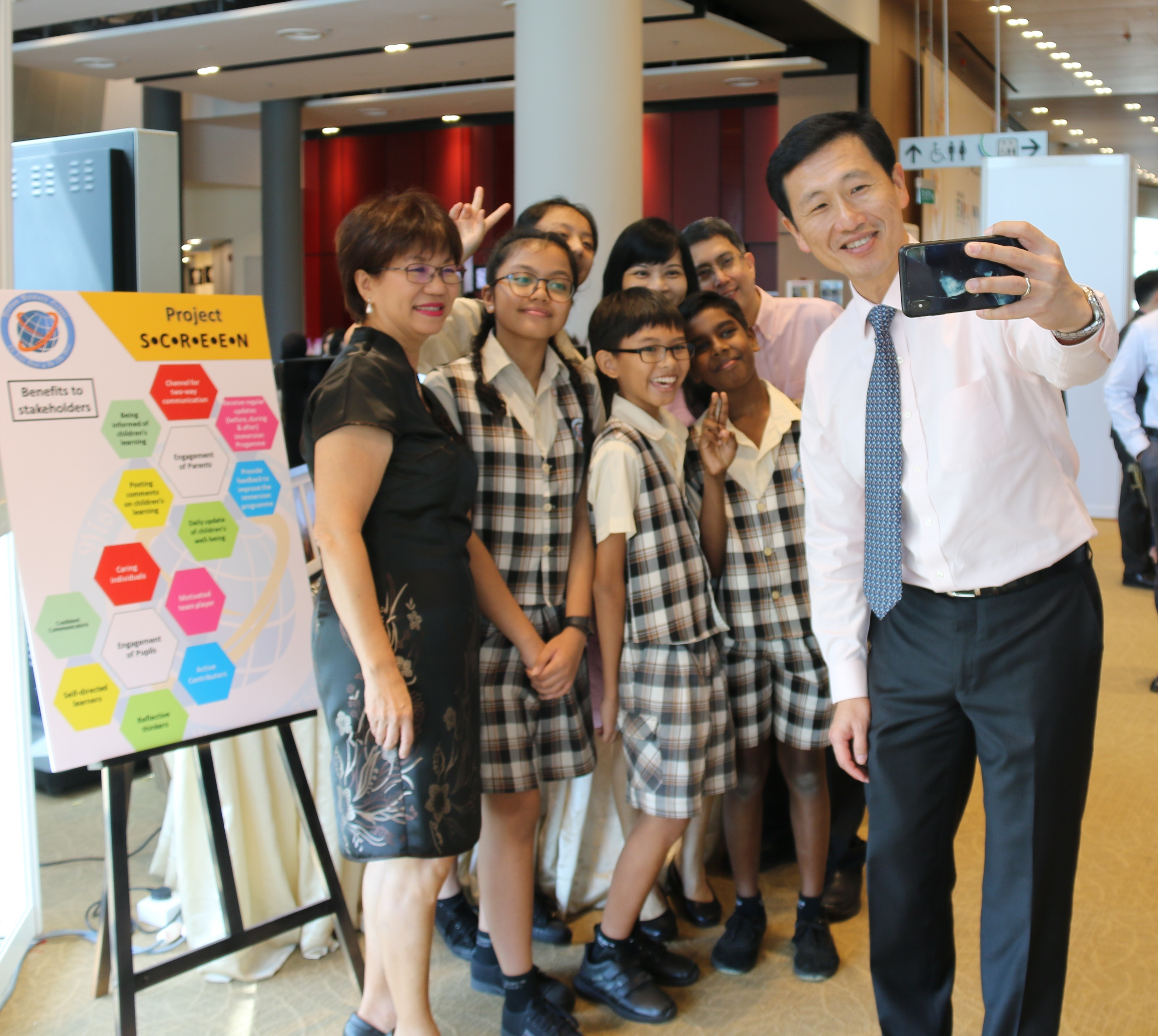 Minister taking a picture with the students.JPG